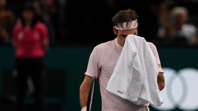 La déception de Federer qui a livré une belle bataille contre le Serbe. [Christophe Archambault - AFP]