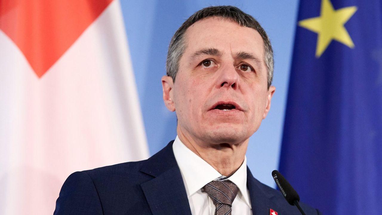 Ignazio Cassis n'est pas pressé pour que la Suisse signe le pacte sur les migrations. [Hayoung Jeon - EPA/Keystone]
