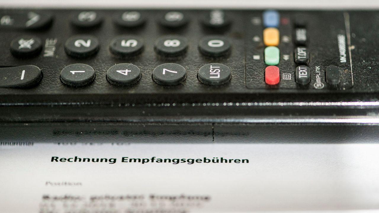 Un téléspectateur a obtenu le remboursement de la TVA sur d'anciennes factures de redevance radio-tv. [Christian Beutler - Keystone]