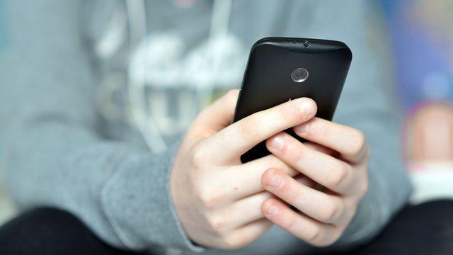 La problématique du harcèlement sur les réseaux sociaux est grandissante. [Peter Cripps - Fotolia]