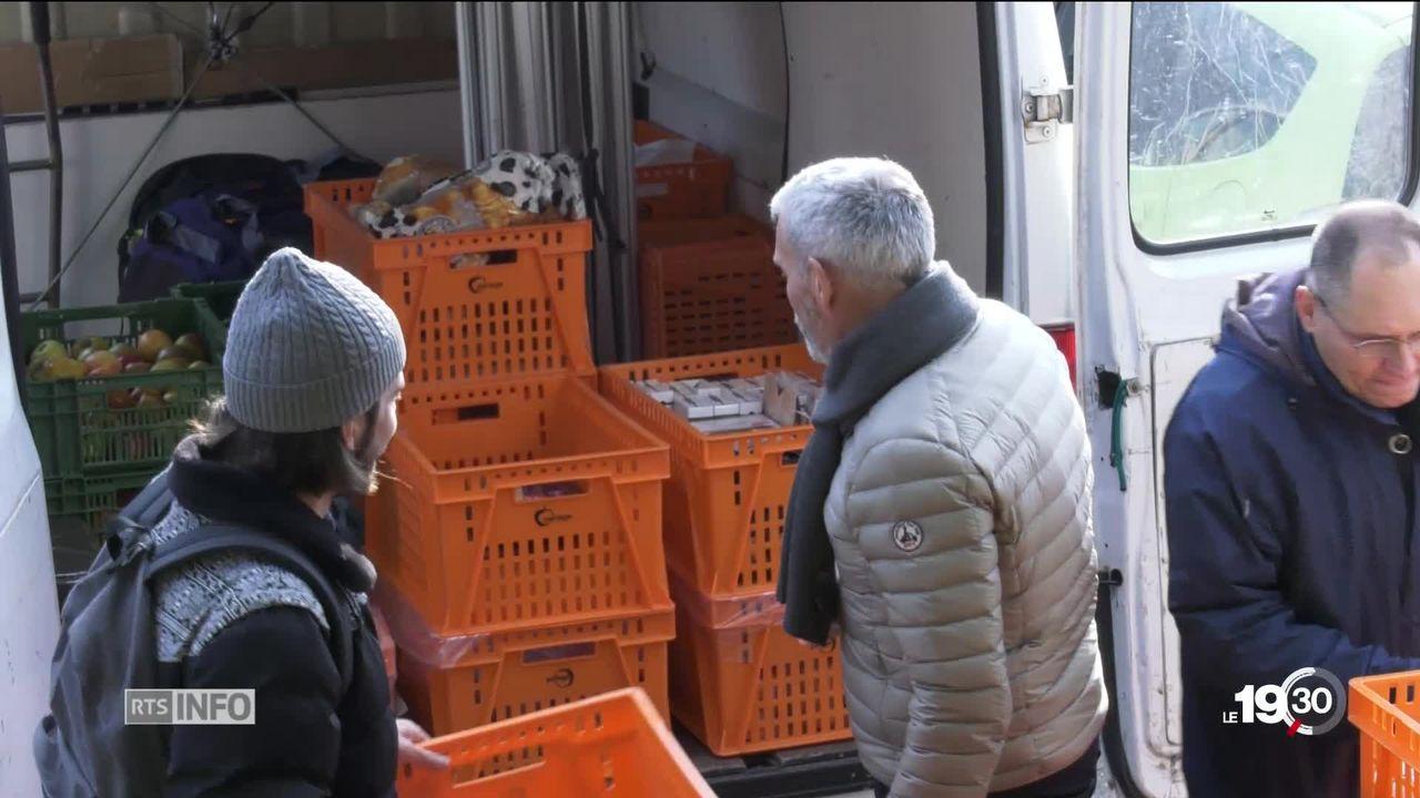Paniers de Noël: la Croix-Rouge genevoise vient en aide aux plus démunis [RTS]