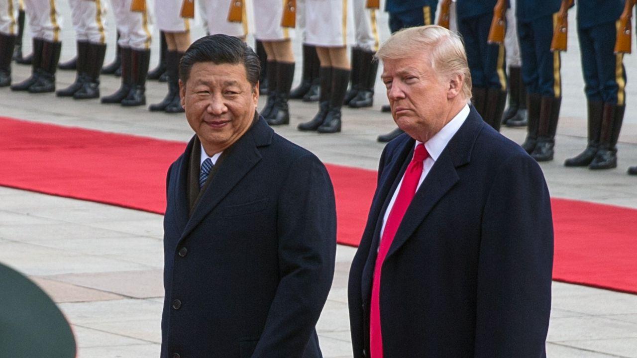 Les tensions entre la Chine et les Etats-Unis sont néfastes pour l'économie. [Roman Pilipey - Keystone/EPA]