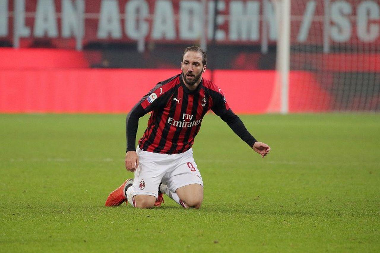 Après la Liga avec le Real et la Serie A avec Napoli, la Juve et le Milan, Higuain va découvrir la Premier League. [Giuseppe Cottini - AFP]