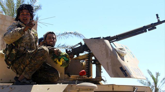Des combattants des Forces démocratiques syriennes dans le village de Baghouz, le 18 mars 2019. [Stringer - Reuters]