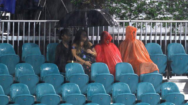 La pluie a joué les trouble-fêtes à Miami. [Luis M. Alvarez - Keystone]
