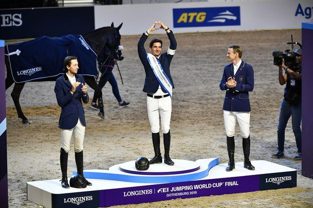Fuchs (à gauche) et Guerdat (au centre) sur le podium. [Bjorn Larsson Rosvall - Keystone]
