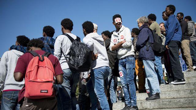 Requérants érythréens lors d'une manifestation contre les renvois à Lausanne en septembre 2014. [Jean-Christophe Bott - Keystone ]