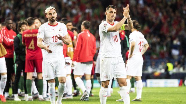 La Suisse de Drmic et Xhaka est tombée avec les honneurs. [Jean-Christophe Bott - Keystone]