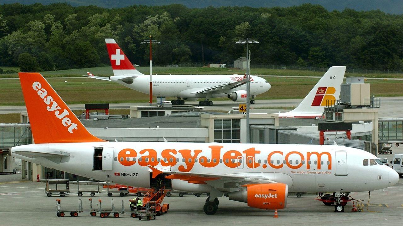Des avions à l'aéroport de Genève. [Martial Trezzini - Keystone ]