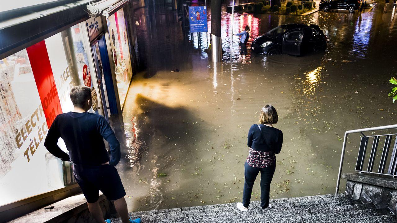 Des pluies torrentielles ont inondé la ville de Lausanne le 11 juin 2018 faisant pour 32 millions de dégâts. Il était tombé 41 millimètres de pluie en 10 minutes. [Jean-Christophe Bott - Keystone]