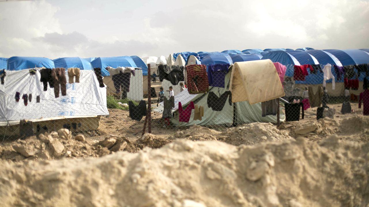 La famille du Genevois se trouve dans le camp d'internement d'Al-Hol contrôlé par les Forces démocratiques syriennes (FDS). [Maya Alleruzzo - Keystone/AP Photo]