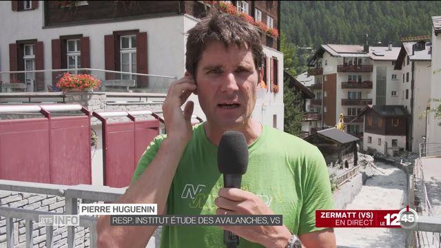 Le village de Zermatt traversé par une masse d'eau boueuse: une poche d'eau sous un glacier s'est rompue. Les explications de Pierre Huguenin. [RTS]