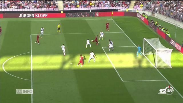 Retour sur la match amical entre Liverpool et l'Olympique lyonnais hier soir au stade de Genève avec la victoire des Anglais 3-1. [RTS]