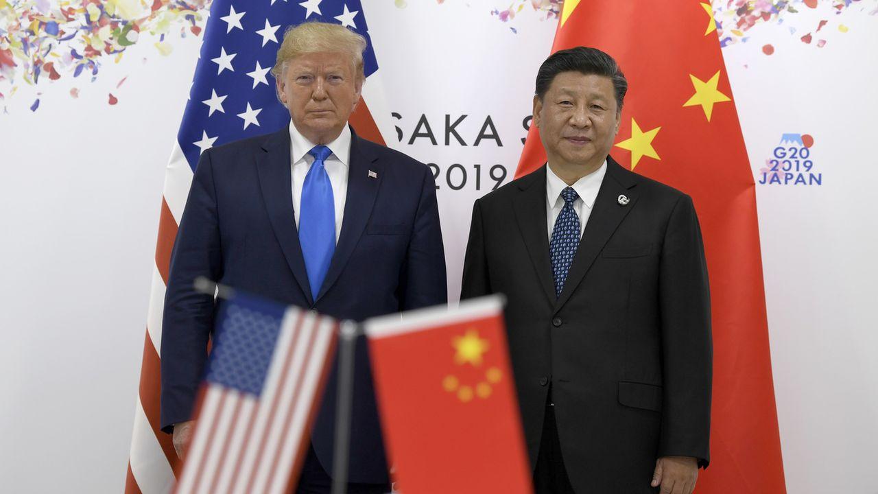 Donald Trump et Xi Jinping lors du sommet du G20 à Osaka. [Susan Walsh - AP/Keystone]