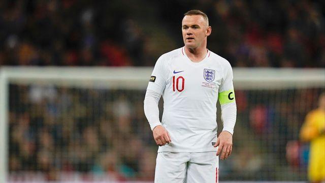 """Rooney avec le brassard de capitaine lors de son ultime match pour les """"Three Lions"""" en novembre 2018. [JASON BROWN - AFP]"""