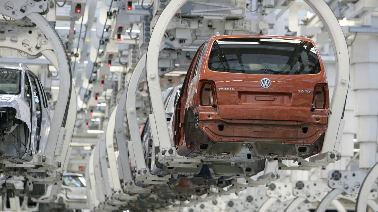 L'industrie automobile est particulièrement touchée. [Joerg Sarbach - AP Photo/Keystone]