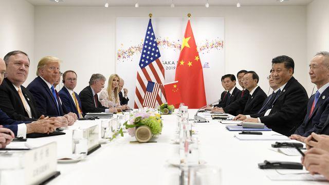 Rencontre entre délégations américaine et chinoise lors du G20 à Osaka, 29.06.2019. [Susan Walsh - AP/Keystone]