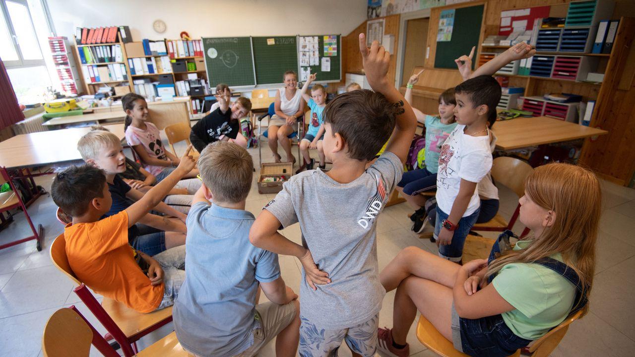 A l'école, la question climatique devient de plus en plus présente. [DPA/Marijan Murat - Keystone]