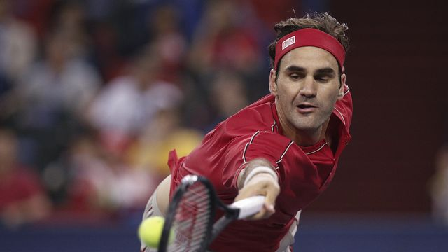 Federer dans ses oeuvres. [Andy Wong - Keystone]