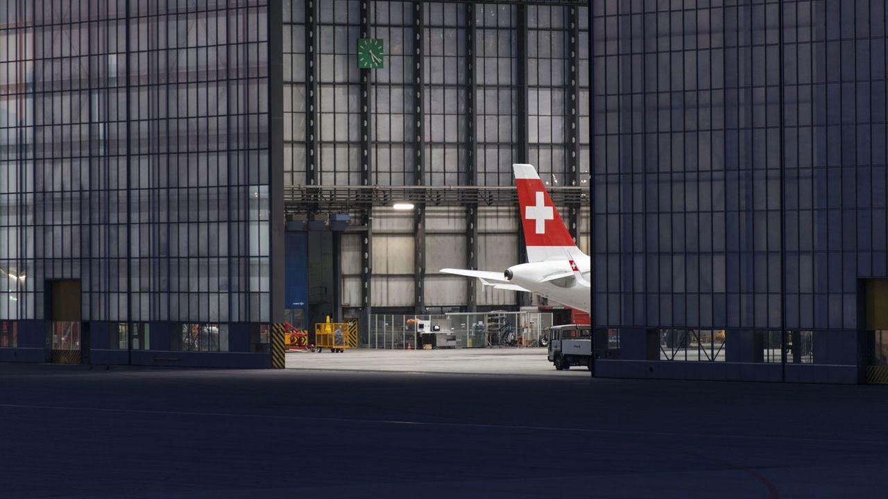 """Un avion de la compagnie """"Swiss"""" en révision à l'aéroport de Zurich. [Christian Beutler - Keystone]"""