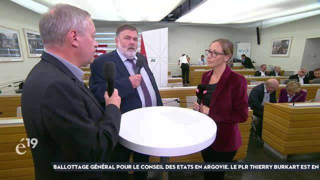 Les conseillers nationaux jurassiens Pierre-Alain Fridez (PS) et Jean-Paul Gschwind (PDC) commentent avec sérénité les résultats partiels des élections fédérales dans leur canton [RTS]
