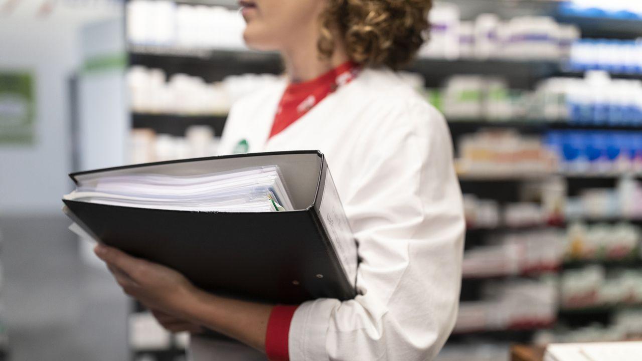 Les pharmaciens se mobilisent pour demander la révision de la politique d'économie de la Confédération en matière de santé. [Gaetan Bally - Keystone]