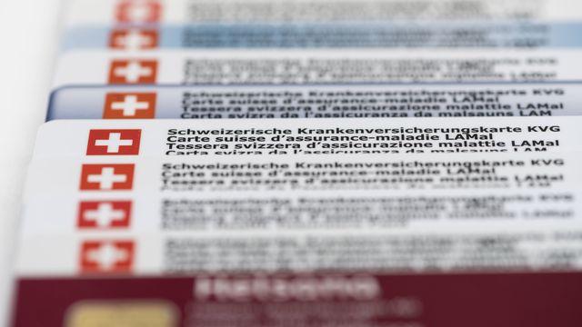 Cartes d'assurances maladie suisses. [Christian Beutler - Keystone]