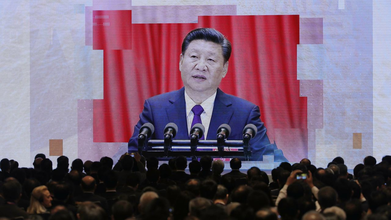 Le président Xi Jinping annonce le ''Outline Development Plan for the Guangdong-Hong Kong-Macao, Greater Bay Area'' à Hong Kong en février 2019. [Kin Cheung - AP/Keystone]