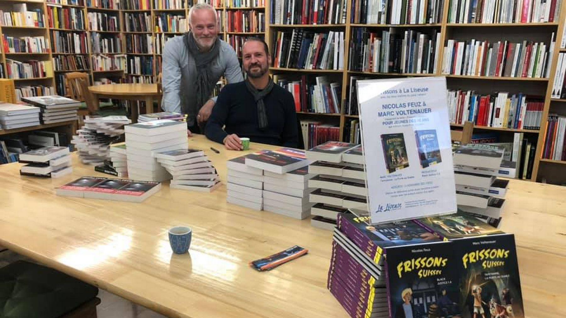 Marc Voltenauer et Nicolas Feuz en dédicace à la librairie La Liseuse à Sion.