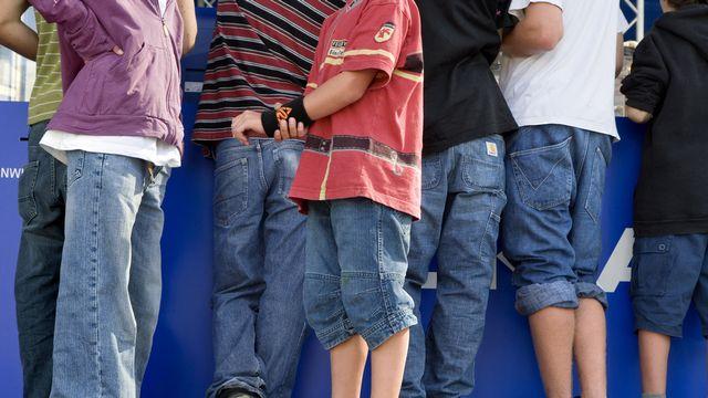 Les jeunes adolescents suisses sont plus de 85% à ne pas faire suffisamment d'activité physique, selon l'OMS. [Martin Rütschi - Keystone]
