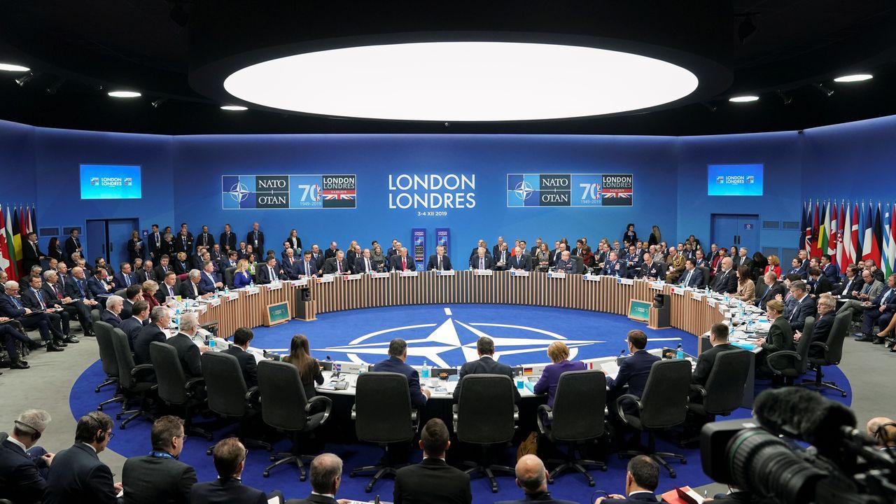Les 29 membres de l'OTAN adoptent une déclaration finale malgré les tensions. [Kevin Lamarque - Reuters]