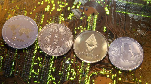 Une cryptomonnaie publique serait inutile et risquée, estime le Conseil fédéral (image d'illustration). [Dado Ruvic - Reuters]