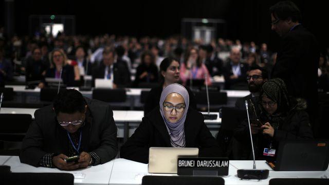Des participants à la COP25, le 14 décembre 2019 à Madrid. [Manu Fernandez - AP/Keystone]
