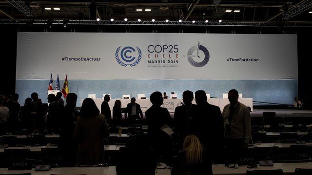 La COP25 s'achève en demi-teinte à Madrid. [AP Photo/Bernat Armangue - Keystone]