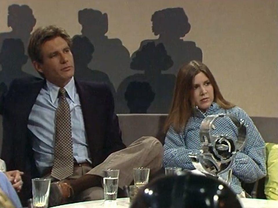 Les acteurs du film La Guerre des étoiles Harrison Ford et Carrie Fisher en 1977. [RTS]