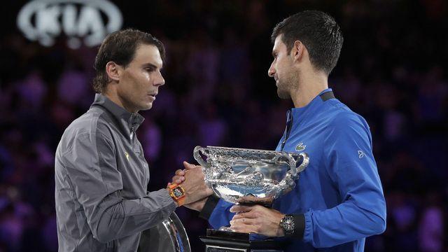 Rafael Nadal et Novak Djokovic, adversaires au quotidien mais complices pour appeler à une fusion des compétitions par pays. [Aaron Favila - AP]