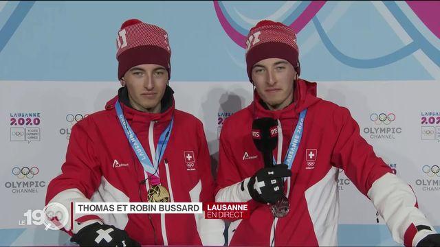 Thomas et Robin Bussard, les jumeaux de 16 ans, ont décroché chacun une médaille. Leurs émotions en direct à Lausanne. [RTS]