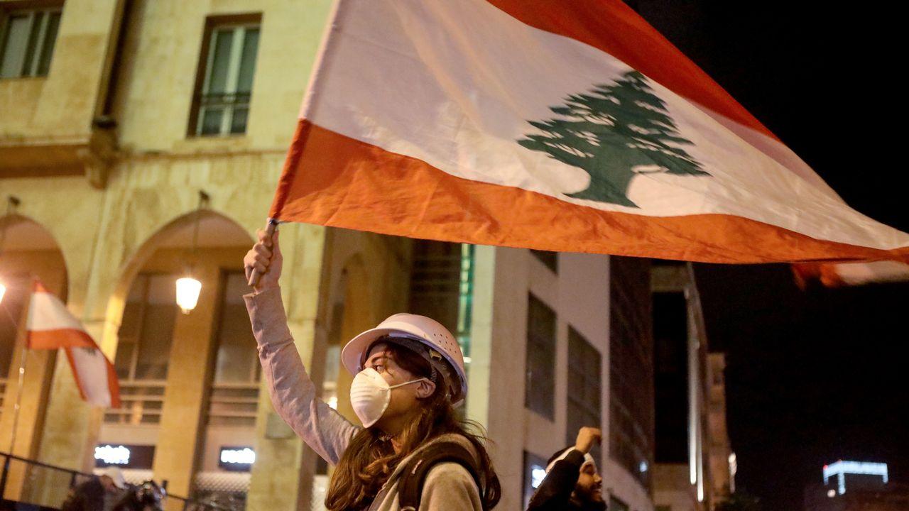 A l'annonce du nouveau gouvernement, des manifestants sont à nouveau descendus,mardi, dans les rues de diverses villes libanaises. [Patrick BAZ - AFP]