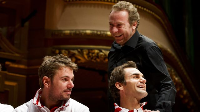 Marc Rosset, ici avec Stan Wawrinka et Roger Federer à Genève, espère que les Suisses poursuivront leur chemin à l'Open d'Australie. [Salvatore Di Nolfi - Keystone]