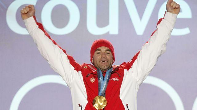 Le jour de gloire pour Didier Defago qui décroche l'or en descente. [Peter Klaunzer - Keystone]