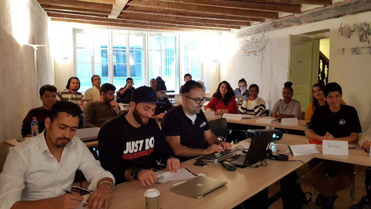 Une classe du programme de formation Powercoders, en 2018 à Bâle. [Powercoders]