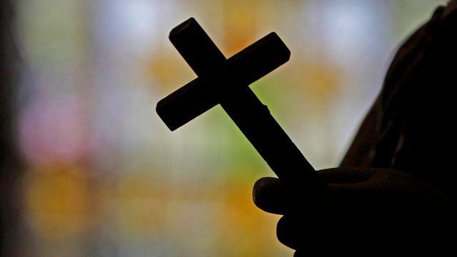 Une silhouette dans une église de la Nouvelle-Orléans (photo prétexte). [AP Photo/Gerald Herbert - Keystone]