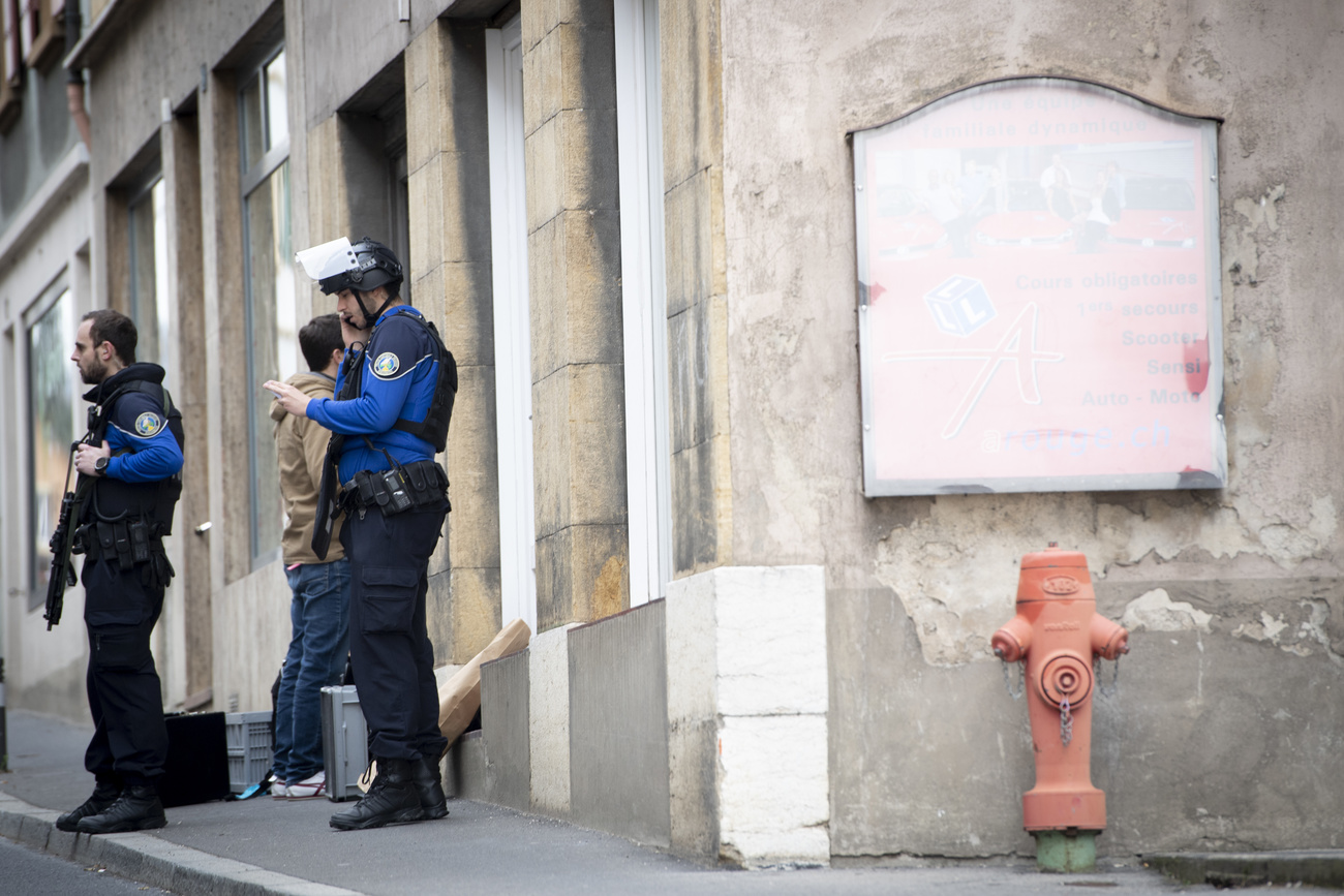Police are seen in front of the house where a shooting took place, in Grandson on the Lake of Neuchatel, Switzerland, Saturday, February 29, 2020. (KEYSTONE-Laurent Gillieron)