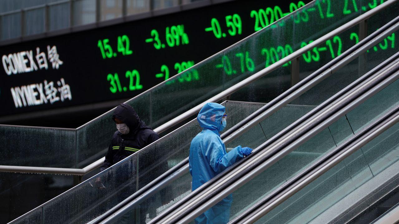 Les Bourses suisses et mondiales tentent de rebondir après un jeudi noir. [Aly Song - Reuters]