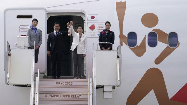 La flamme olympique est sur le sol du Japon depuis vendredi. [Eugene Hoshiko - Keystone]