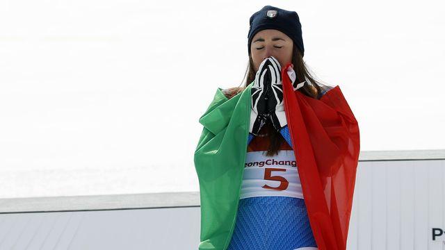 Sofia Goggia le 21 février 2018 lors de sa victoire en descente aux Jeux de PyeongChang. [Christophe Ena - Keystone]