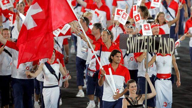 La délégation suisse devra normalement patienter une année de plus avant de prendre part à la cérémonie d'ouverture des Jeux. [Fabrice Coffrini - Keystone]