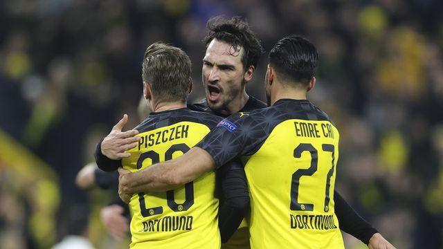Lukas Piszczek, Mats Hummels et Emre Can, trois des joueurs du BvB qui reprendront l'entraînement ce lundi. [Friedemann Vogel - AP]