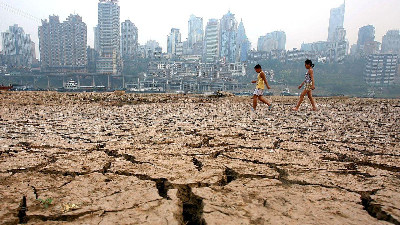 Tous les indicateurs font état d'une accélération du changement climatique (illustration à Chongqing en Chine). [Color China Photo - AP/Keystone]