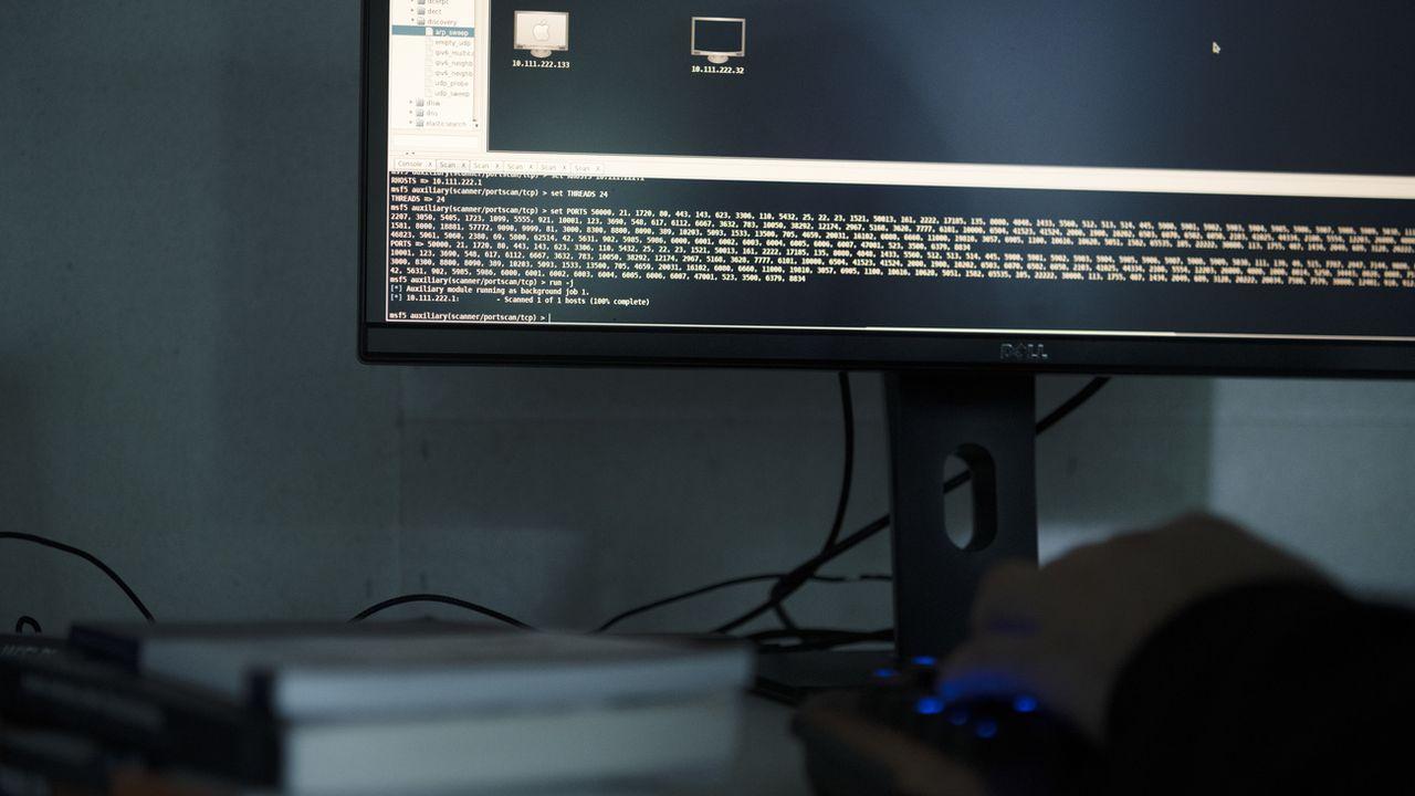 Le télétravail constitue un risque pour la sécurité informatique des pouvoirs publics. [Keystone]